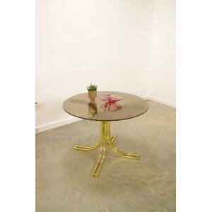 Vintage ronde eettafel messing rookglas, messing eetkamerstoelen, draadstaal stoel, wire stoel